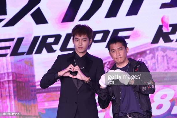 Actors Kris Wu Yifan and Tony Leung Chiuwai attend 'Europe Raiders' press conference on August 13 2018 in Beijing China