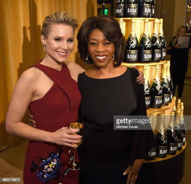 Actors Kristen Bell and Alfre Woodard attend Moet Chandon Toasts The 75th Annual Golden Globe Awards Nominations at The Beverly Hilton Hotel on...