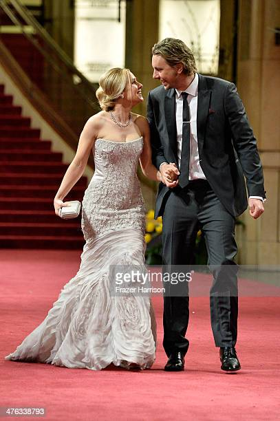 Actors Kristen Bell and Dax Shepard depart the Oscars at Hollywood & Highland Center on March 2, 2014 in Hollywood, California.