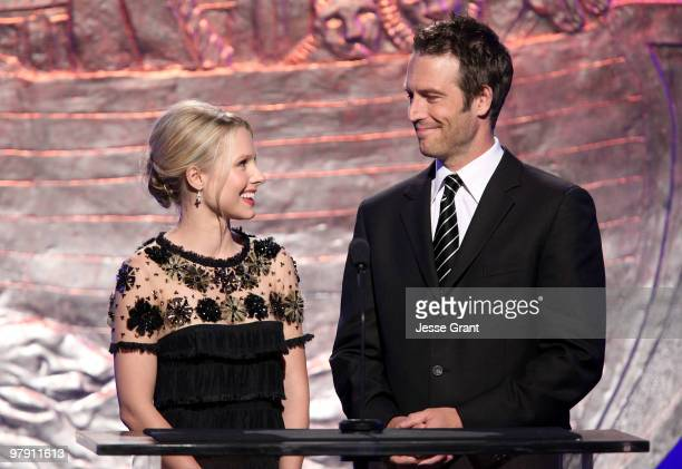 Actors Kristen Bell and Michael Vartan speak on stage at the 24th Genesis Awards at The Beverly Hilton Hotel on March 20 2010 in Beverly Hills...