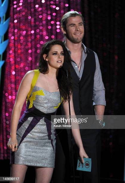 Actors Kristen Stewart and Chris Hemsworth speak onstage during the 2012 MTV Movie Awards held at Gibson Amphitheatre on June 3 2012 in Universal...