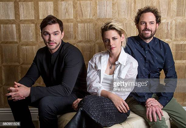 Actors Kristen Stewart Nicholas Hoult and director Drake Doremus of 'Equals' are photographed for Los Angeles Times on July 8 2016 in Los Angeles...