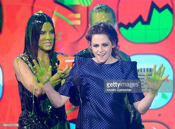 Actors Kristen Stewart winner of Favorite Movie Actress for 'The Twilight Saga Breaking Dawn – Part 2' and Sandra Bullock speak onstage during...