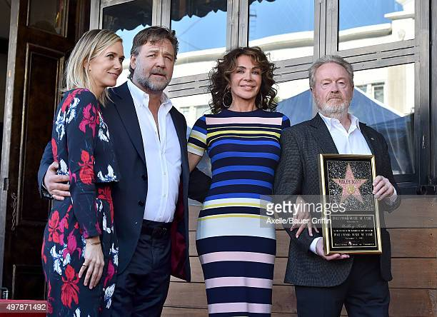 Actors Kristen Wiig and Russell Crowe, Giannina Facio and director Ridley Scott attend the ceremony honoring Ridley Scott with a star on the...