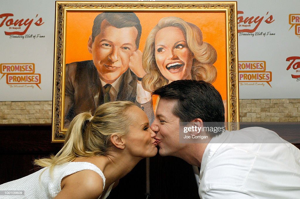 Actors Kristin Chenoweth and Sean Hayes play up to the crowd and kiss during their portrait unveiling at Tony's di Napoli on May 20, 2010 in New York City.