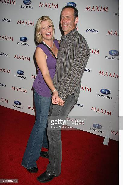 Actors Kristy Swanson and Lloyd Eisler attend MAXIM Magazine's ICU Celebration of Extreme Sports at Area on August 2 2007 in West Hollywood California