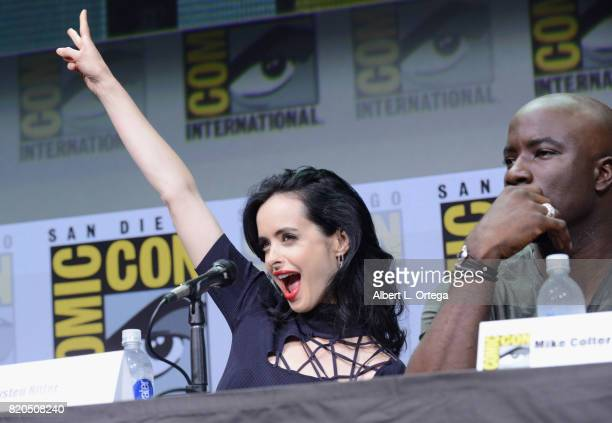 Actors Krysten Ritter and Mike Colter speak onstage at Netflix's 'The Defenders' panel during ComicCon International 2017 at San Diego Convention...