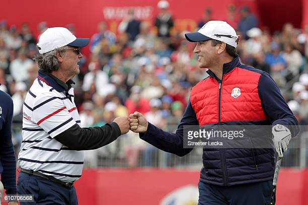 Actors Kurt Russell and Rob Riggle of the United States walk off the first tee during the 2016 Ryder Cup Celebrity Matches at Hazeltine National Golf...