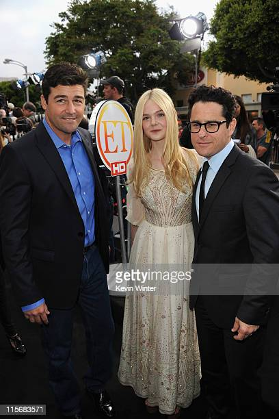 Actors Kyle Chandler and Elle Fanning and writer/director JJ Abrams arrive at the premiere of Paramount Pictures' 'Super 8' at Regency Village...