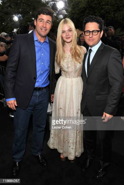Actors Kyle Chandler and Elle Fanning and writer/director JJ Abrams arrive at the Super 8 Los Angeles Premiere held at Regency Village Theatre on...