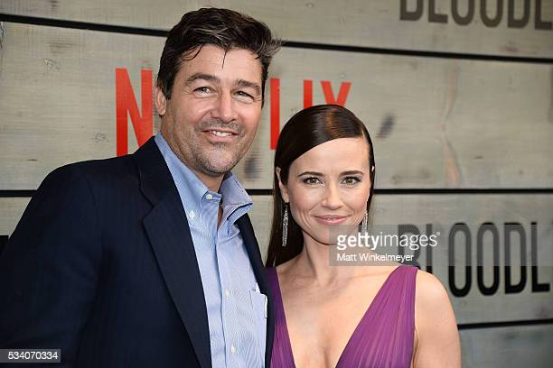 Actors Kyle Chandler and Linda Cardellini attend the Premiere of Netflix's Bloodline at Westwood Village Theatre on May 24 2016 in Westwood California