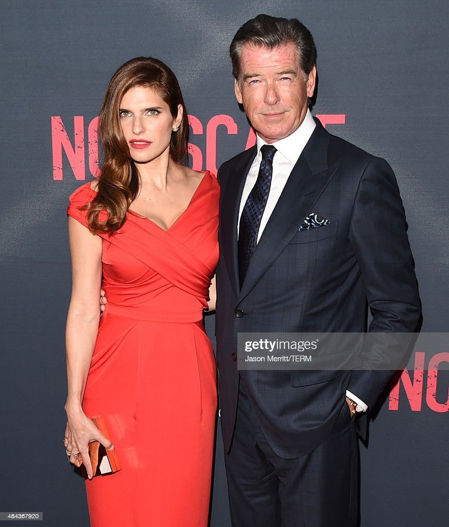 Actors Lake Bell (L) and Pierce Brosnan attend the premiere of the Weinstein Company's 'No Escape' at Regal Cinemas L.A. Live on August 17, 2015 in Los Angeles, California.