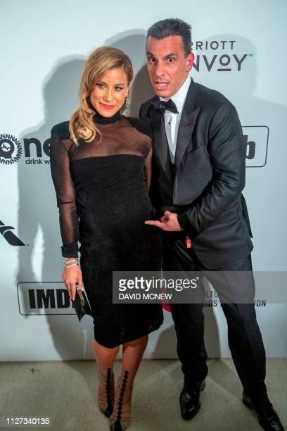 US actors Lana Gomez and Sebastian Maniscalco arrive to attend the Elton John AIDS Foundation Academy Awards Viewing Party in West Hollywood...