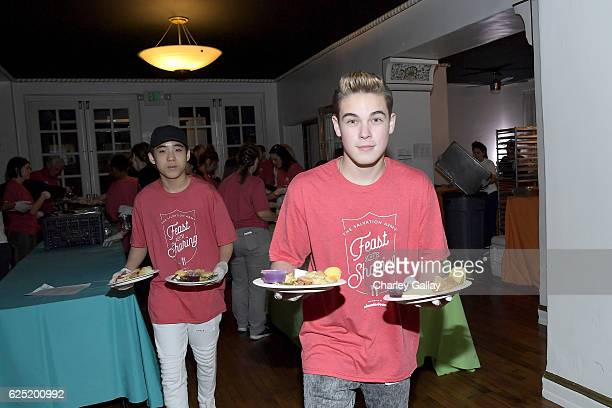Actors Lance Lim from School of Rock and Ricardo Hurtado from Glitch Techs attend the 'Salvation Army's Feast of Sharing Holiday Dinner' presented by...