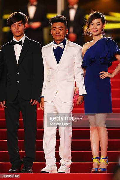 Actors Lanshan Luo and Baoqiang Wang and Ma Rong attend the Premiere of 'Tian Zhu Ding' during The 66th Annual Cannes Film Festival at Palais des...