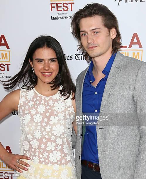 Actors Lara Vosburgh and Morgan McClellan attend the 2014 Los Angeles Film Festival opening night premiere of Snowpiercer at Regal Cinemas LA Live on...