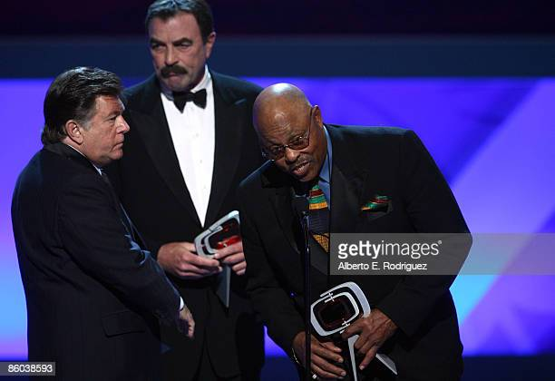Actors Larry Manetti Tom Selleck and Roger E Mosley accept the Hero Award for Magnum PI onstage at the 7th Annual TV Land Awards held at Gibson...