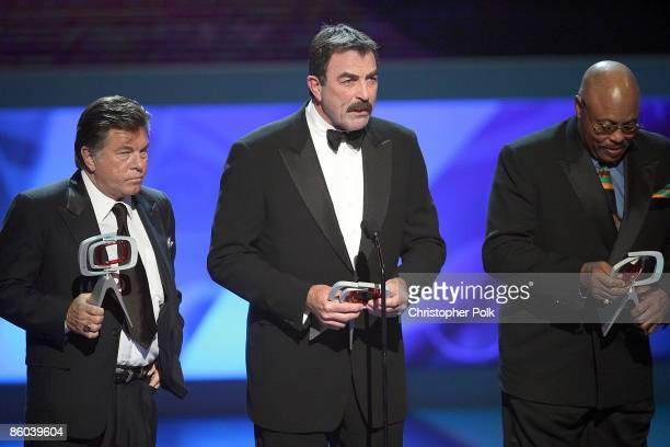Actors Larry Manetti Tom Selleck and Roger E Mosley of Magnum PI onstage during the 7th Annual TV Land Awards held at Gibson Amphitheatre on April 19...
