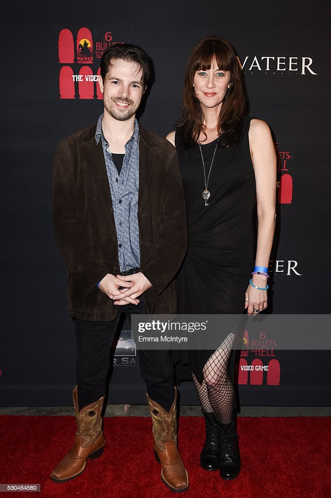 Actors Larry Swallow (L) and Andie Karvelis attend the launch of '6 Bullets to Hell' on May 10, 2016 in Los Angeles, California.