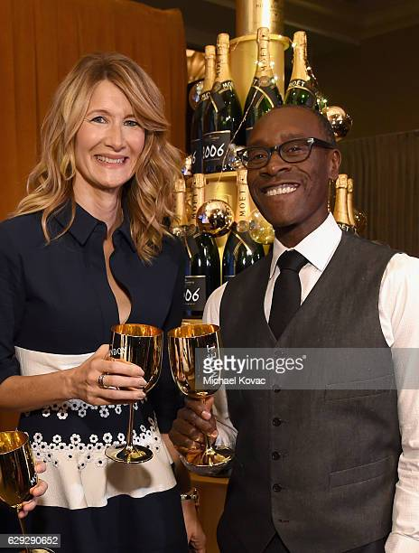 Actors Laura Dern and Don Cheadle attend Moet Chandon toast to the 74th Annual Golden Globe Awards nominations on December 12 2016 in Los Angeles...