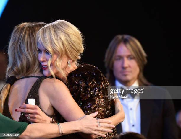 Actors Laura Dern Nicole Kidman and singer Keith Urban onstage during the 24th Annual Screen Actors Guild Awards at The Shrine Auditorium on January...