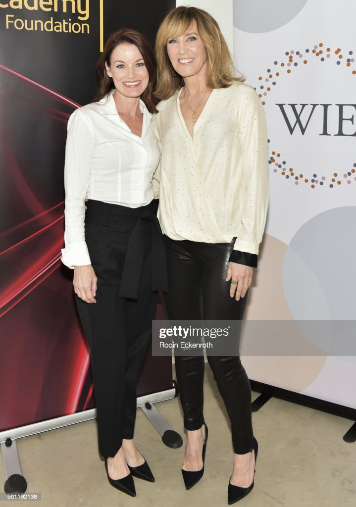 Actors Laura Leighton-Savant (L) and Felicity Huffman pose for portrait at the Women in Entertainment and The Television Academy Foundation's Inaugural Women in Television Summit at Saban Media Center on May 21, 2018 in North Hollywood, California.
