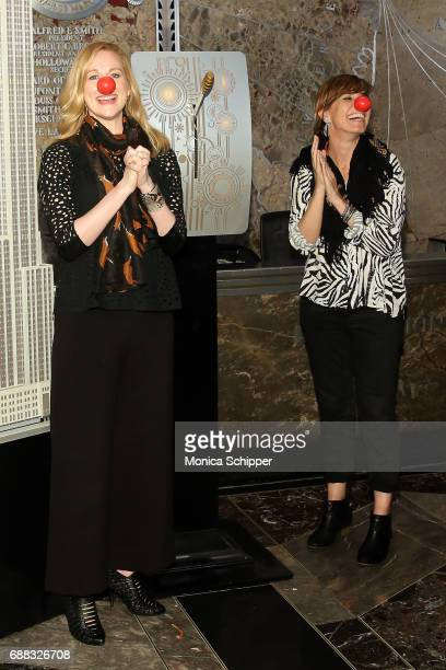 Actors Laura Linney and Lucia Moniz light The Empire State Building in honor of Red Nose Day at The Empire State Building on May 25 2017 in New York...