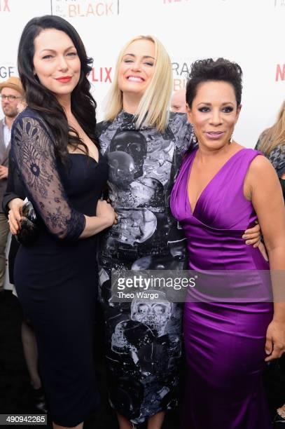 Actors Laura Prepon Taylor Schilling and Selenis Leyva attend the Orange Is The New Black season two premiere at Ziegfeld Theater on May 15 2014 in...