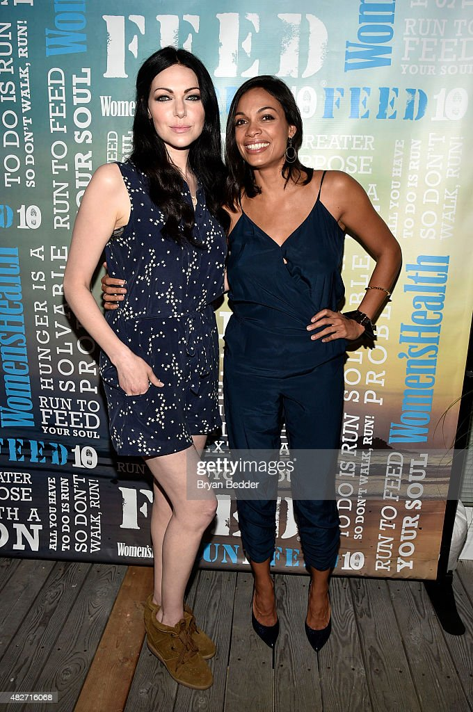 Actors Laura Prepron and Rosario Dawson attend the Women's Health's 4th annual party under the stars for RUN10 FEED10 on August 1, 2015 in Bridgehampton, New York.