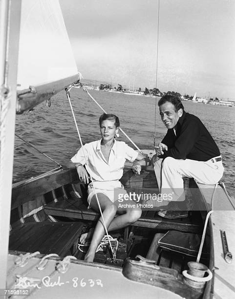 Actors Lauren Bacall and Humphrey Bogart enjoy a day's sailing circa 1945