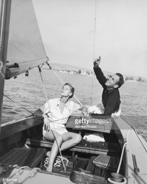 Actors Lauren Bacall and Humphrey Bogart enjoy a day's sailing circa 1945
