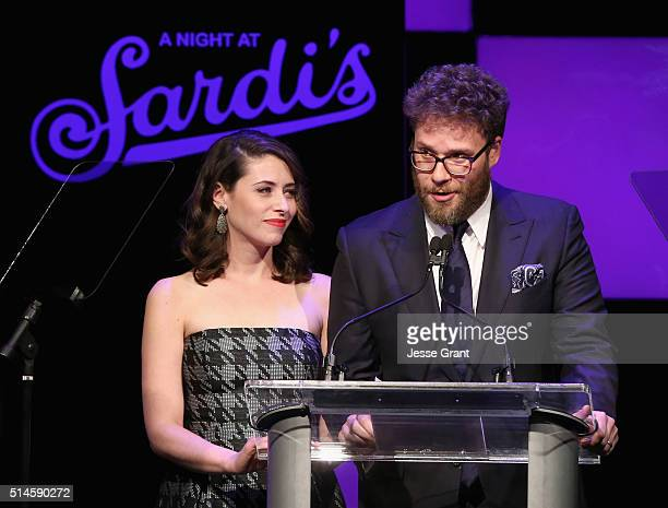 Actors Lauren Miller and Seth Rogen speak onstage during the 24th and final A Night at Sardi's to benefit the Alzheimer's Association at The Beverly...
