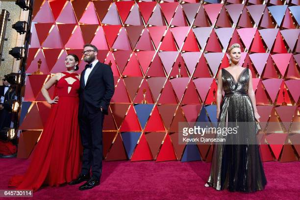 Actors Lauren Miller Seth Rogen and Charlize Theron attend the 89th Annual Academy Awards at Hollywood Highland Center on February 26 2017 in...