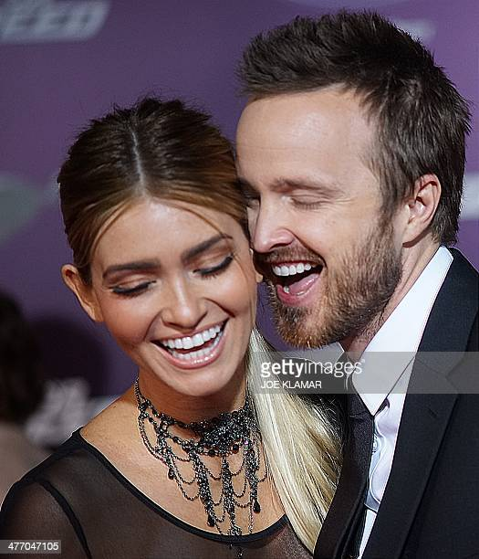 Actors Lauren Parsekian and Aaron Paul arrive at the premiere of DreamWorks Pictures' 'Need For Speed' at TCL Chinese Theatre on March 6, 2014 in...