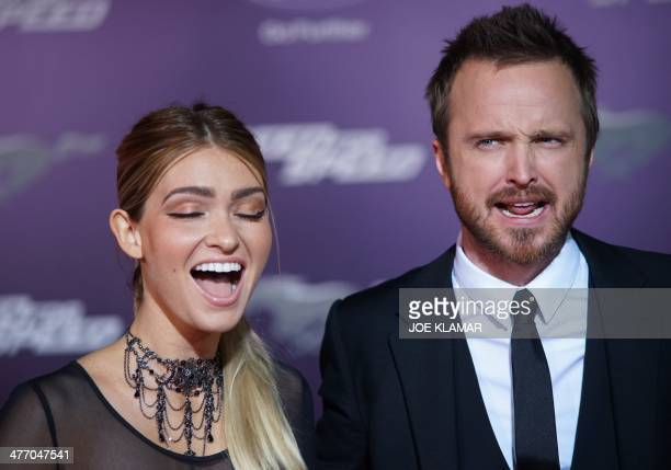 Actors Lauren Parsekian and Aaron Paul arrive at the premiere of DreamWorks Pictures' 'Need For Speed' at TCL Chinese Theatre on March 6 2014 in...