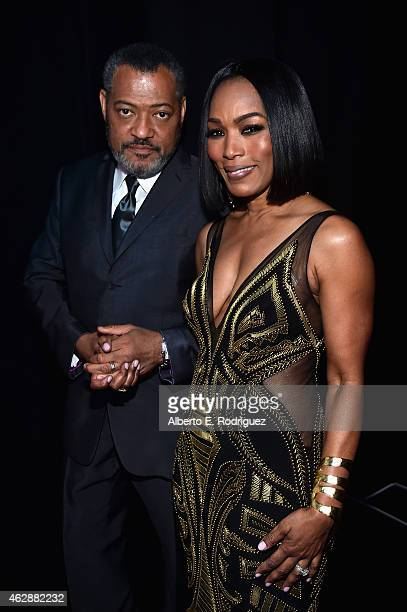 Actors Laurence Fishburne and Angela Bassett attend the 46th NAACP Image Awards presented by TV One at Pasadena Civic Auditorium on February 6 2015...