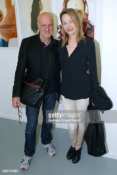 L Actors Laurent Spielvogel and Gabrielle Lazure attend the 55 Politiques Exhibition of Stephanie Murat's Pictures Opening Party at Galerie Dupin on...