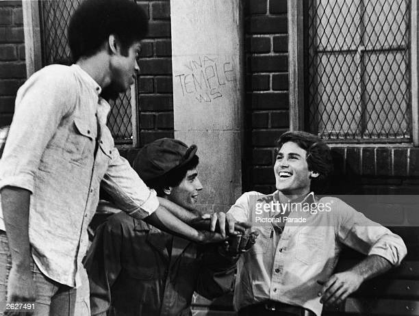 Actors Lawrence HiltonJacobs Robert Hegyes and Stephen Shortridge clasp hands in a still from the television series 'Welcome Back Kotter' 1978