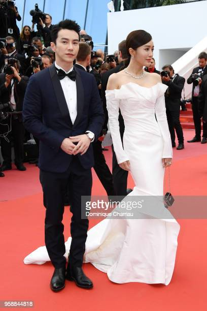Actors Lawrence Wong and Qin Lan arrive for the screening of Solo A Star Wars Story red carpet arrivals during the 71st annual Cannes Film Festival...