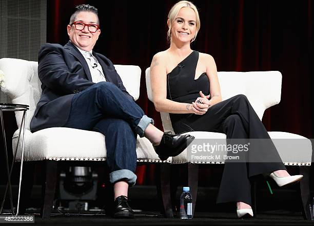 """Actors Lea DeLaria and Taryn Manning speak onstage during the """"Orange Is the New Black"""" panel discussion at the Netflix portion of the 2015 Summer..."""