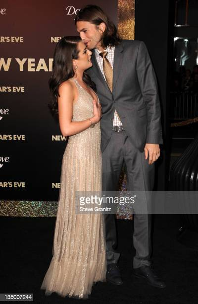 "Actors Lea Michele and Ashton Kutcher arrive at the Los Angeles premiere of ""New Year's Eve"" at Grauman's Chinese Theatre on December 5, 2011 in..."