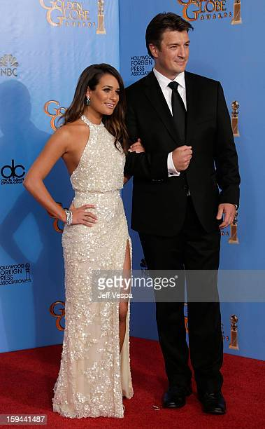 Actors Lea Michele and Nathan Fillion pose in the press room at the 70th Annual Golden Globe Awards held at The Beverly Hilton Hotel on January 13...