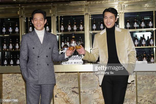 Actors Lee JungJae and Jung WooSung attend the photocall for Pernod Ricard Korea Ballantine's 'Wanna Meet A Single' campaign on December 6 2018 in...