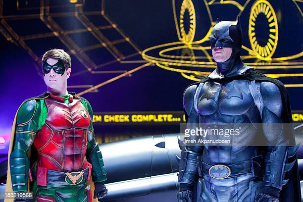 Actors Lee Matthews and Jack Walker pose on stage in costume as Robin and Batman during the 'Batman Live' Media Day at Staples Center on September...