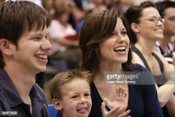 Actors Lee Norris Jackson Brundage and Sophia Bush watch the action during the 5th Annual James Lafferty/One Tree Hill Charity Basketball Game on the...