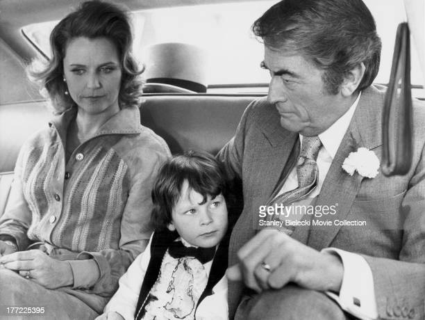 Actors Lee Remick and Gregory Peck with child star Harvey Stephens in a scene from the movie 'The Omen' 1976