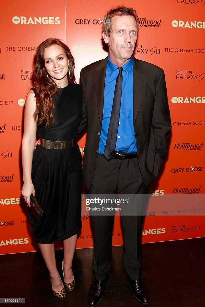 Actors Leighton Meester and Hugh Laurie attend The Cinema Society with The Hollywood Reporter & Samsung Galaxy S III host a screening of 'The Oranges' at Tribeca Screening Room on September 14, 2012 in New York City.