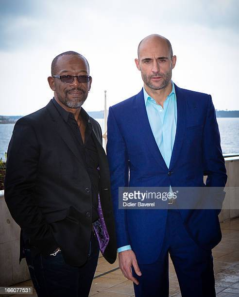 Actors Lennie James and Mark Strong pose during a photocall for the tv series'Low Winter Sun' at MIP TV 2013 on April 8 2013 in Cannes France