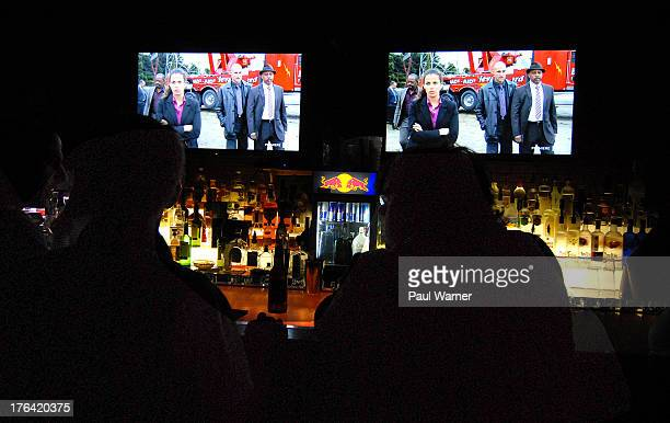 """Actors Lennie James, Athena Karkanis, Mark Strong and Ruben Santiago-Hudson appear onscreen during the """"Low Winter Sun"""" Detroit Viewing Party at The..."""
