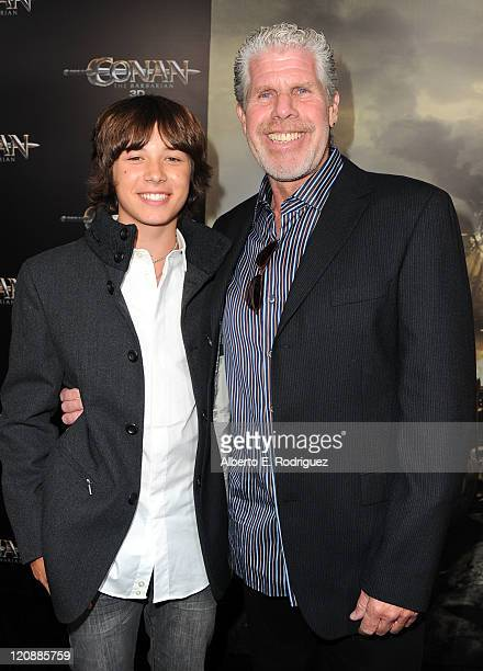 Actors Leo Howard and Ron Perlman arrive at the premiere of Lionsgate Films' Conan The Barbarian on August 11 2011 in Los Angeles California